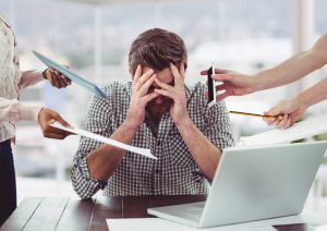 Stressed and burnt out man need energizing in workplace